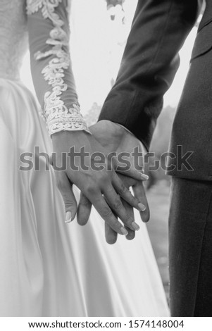 hands of wedding couple  in love. Relationship, love and tenderness concept #1574148004