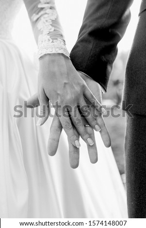 hands of wedding couple  in love. Relationship, love and tenderness concept #1574148007