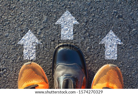 Shoes standing at the crossroad and get to decision which way to go. Ways to choose concept. #1574270329