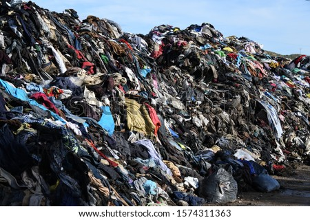 Burnt clothes on a bin in the province of Alicante, Costa Blanca, Spain #1574311363