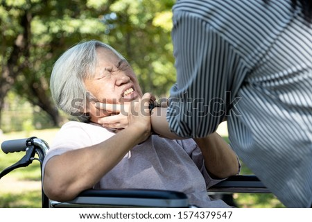 Asian senior mother were physically abused,angry daughter or female caregiver use hands to strangle old people neck and fight, hit, attack,physical abuse elderly alzheimer patient,family stop violence #1574379547