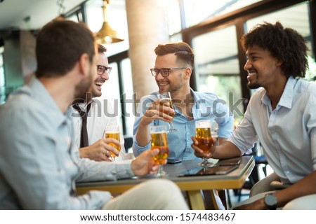 Funny conversation four businessmen while sit pub and drinking beer after work #1574483467