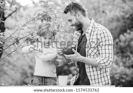 Nutrition kids and adults. Organic nutrition. Healthy nutrition concept. Nutrition habits. Family enjoy homemade meal. Personal example. Father teach son eat natural food. Little boy and dad eat. #1574533762