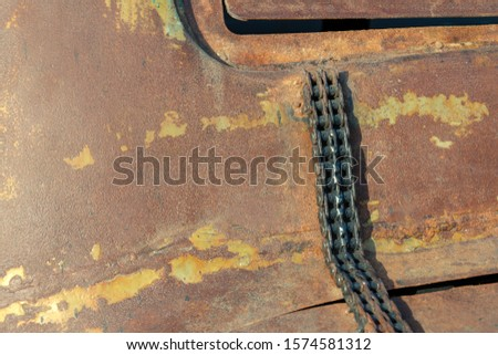 rusty background. on rusty metal is an old motor chain. time concept. old gear #1574581312
