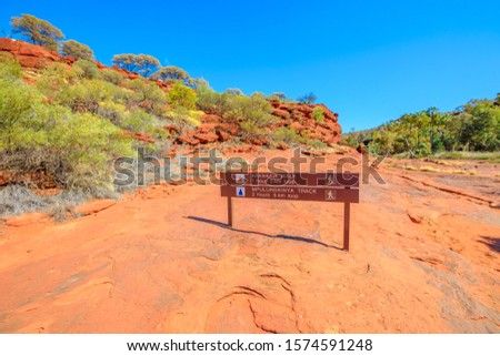 Arankaia Walk and Mpulungkinya Trak sign, trekking among the groves of palms across the plateau around Palm Valley in Finke Gorge National Park. Northern Territory, Central Australia Outback. Royalty-Free Stock Photo #1574591248