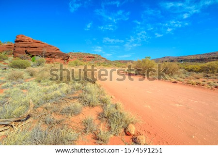 The track that follows the sandy bed of Finke River limited to 4WD vehicles only to Palm Valley in Finke Gorge National Park near Hermannsburg, Northern Territory, Central Australia Outback. Royalty-Free Stock Photo #1574591251