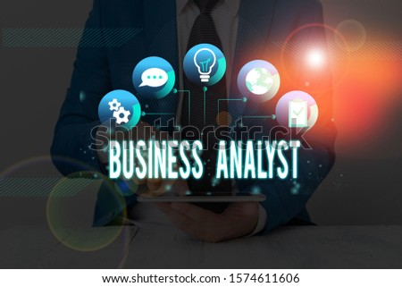 Handwriting text Business Analyst. Concept meaning someone who analyzes an organization or business domain. #1574611606