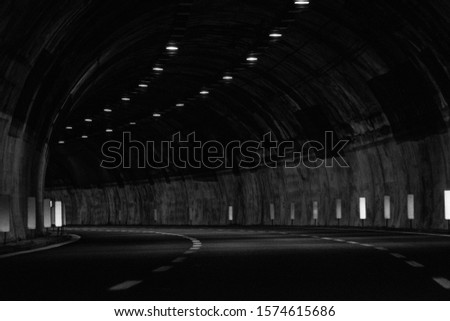 Long exposure photo of car tunnels in motion