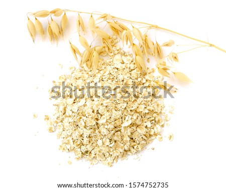 Flat lay, top view oats and oatmeal. Oat seeds are, oatmeal flakes isolated on white with a shadow. Oat seeds, dry rolled oats isolated on a white background. Ear of oats and cereal on white. #1574752735