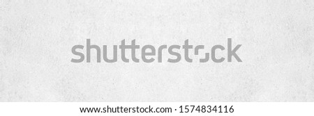 Wide grey paint limestone wall texture background in white light seamless. Panorama gray cement marble table top floor view concept smooth granite quarry stucco surface bacground grunge pattern. Royalty-Free Stock Photo #1574834116