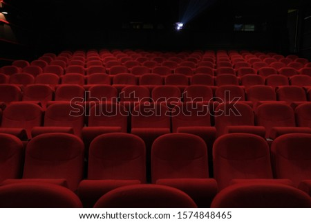 Empty cinema hall with red seats. Movie theatre #1574848465
