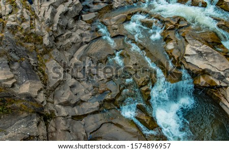 top view aerial landscape of highland rocky cascade waterfall river stream natural scenic background picture