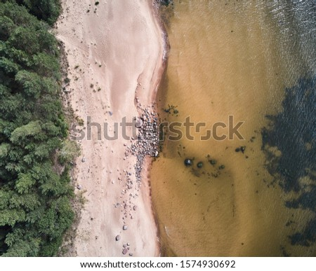 Aerial view of sandy beach and ocean with waves. Royalty-Free Stock Photo #1574930692