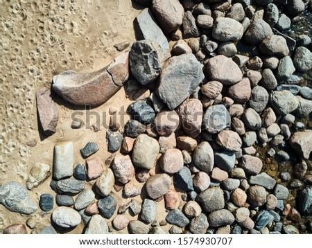 Sea waves lash line impact rock on the beach. Rocks background Royalty-Free Stock Photo #1574930707
