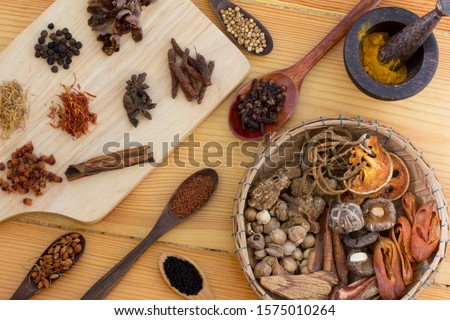 Chinese herb selection used in traditional alternative herbal medicine with mortar and pestle on wood background. Natural herbs medicine and herbal medicinal root. Alternative health care fresh herbal #1575010264