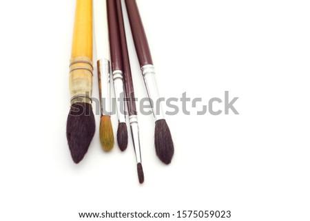 set of round artistic paintbrushes isolated on white background. Artist many paintbrushes. #1575059023