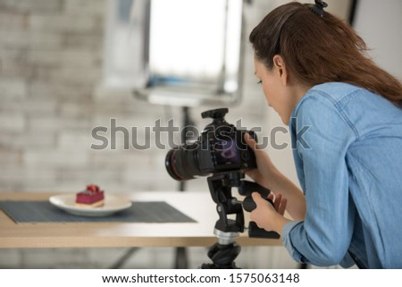 happy woman chef taking a picture of pastries