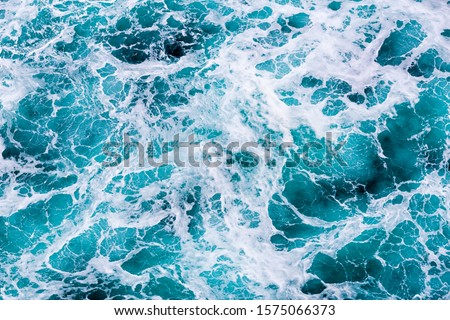Abstract water image shows unique water movement that can be used for backgrounds or as a picture.  This surface ocean image has a unique texture and rich aqua colors. #1575066373