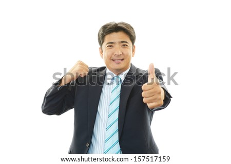 Happy business man showing thumbs up sign #157517159