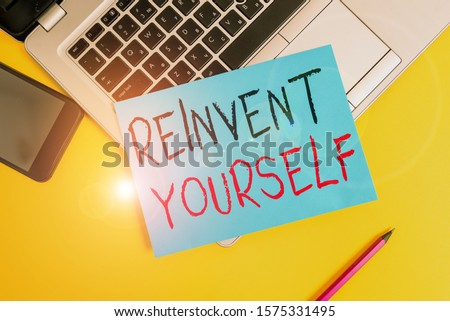 Writing note showing Reinvent Yourself. Business photo showcasing to do something differently from before Change behavior Metallic laptop small paper sheet pencil smartphone colored background. #1575331495