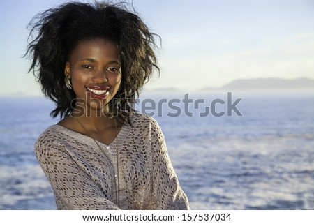 beautiful young long hair woman sitting on the rocks and posing at sunset #157537034