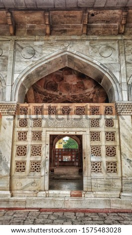 """Marvelous White marble gate, at the """"Chousat Khamba"""" (64 Pillars). This iconic monument is placed on local lanes of Delhi, India. #1575483028"""