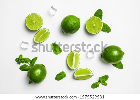 Flat lay composition with fresh juicy limes, mint and ice cubes on white background #1575529531