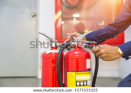 Engineer checking Industrial fire control system,Fire Alarm controller, Fire notifier, Anti fire.System ready In the event of a fire. #1575555325