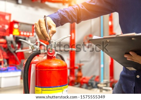 Engineer checking Industrial fire control system,Fire Alarm controller, Fire notifier, Anti fire.System ready In the event of a fire. #1575555349