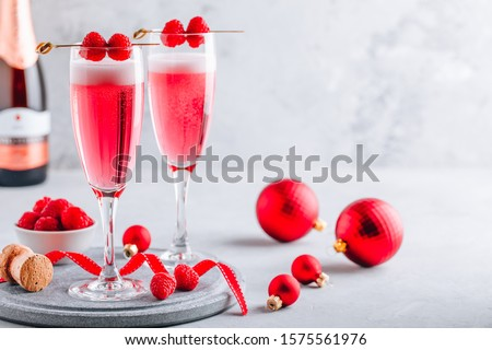 Pink Raspberry Mimosa Cocktail with champagne or prosecco for New Year #1575561976