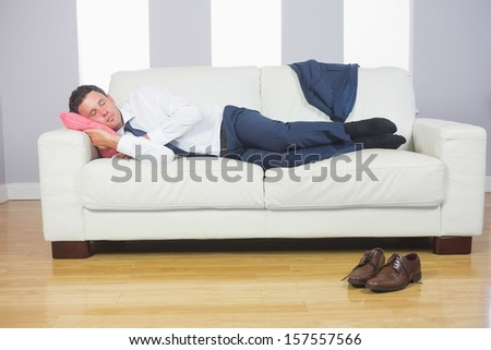 Calm attractive businessman lying on couch after work at home #157557566