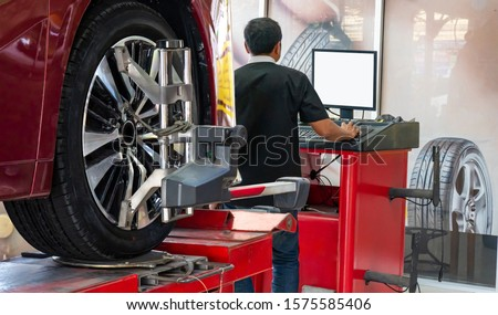 Wheel alignment ,Car on stand with sensors on wheels for wheels alignment camber check in workshop of Service station. #1575585406