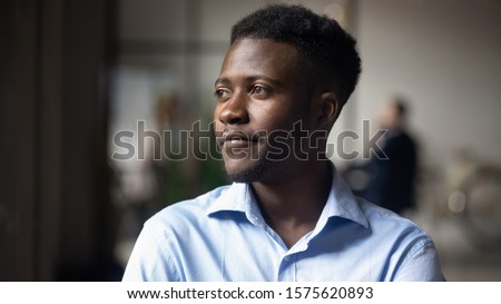 Head shot close up young thoughtful african american businessman entrepreneur looking away. Pensive mixed race confident international company employee manager thinking of problem solution at office. #1575620893