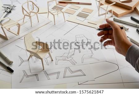 Designer sketching drawing design development product plan draft chair armchair Wingback Interior furniture prototype manufacturing production. designer studio concept .                            #1575621847