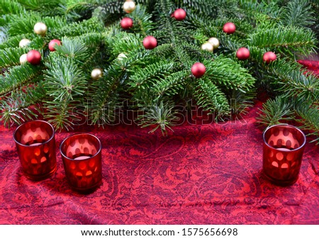Christmas red frame stock images. Xmas decorations balls on tree branch stock images. Christmas tree branch on a red background. Beautiful natural Christmas background. Red Christmas candle stick