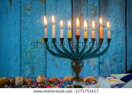 Jewish holiday, Holiday symbol Hanukkah Brightly Glowing Hanukkah Menorah soft focus #1575755617