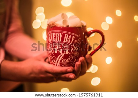 Photo of a cup with a drink and with marshmallows and Christmas candy #1575761911
