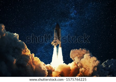 Rocket takes off in the starry sky. Spaceship begins the mission. Space shuttle taking off on a Planet Mars.  #1575766225