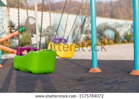 Empty swing at the playground.Empty swing at the playground #1575784072