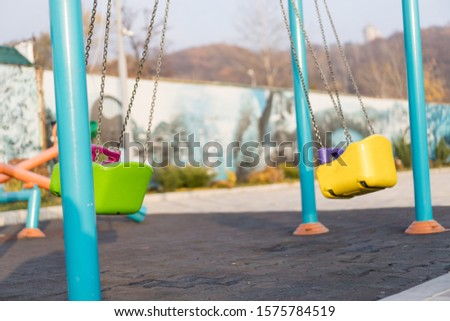 Empty swing at the playground.Empty swing at the playground #1575784519