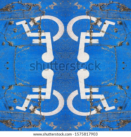traditional universal icon for disabled access and parking zone white on blue painted surface #1575817903