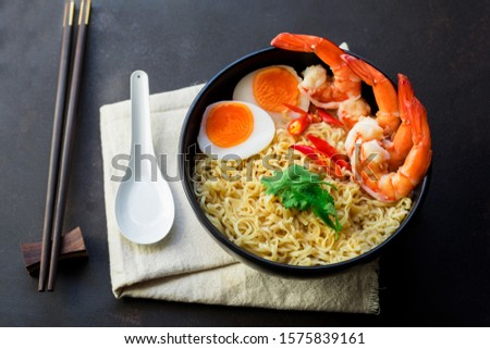 """Tom Yum Kung""on old kitchen table with copy space,hot food and healthy meal concept , It's local in Thai food, Prawn soup is popular and famous food, Pasta, Noodles, Ramen  #1575839161"