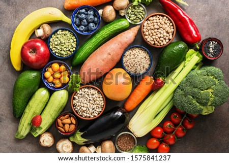 Healthy food for a vegetarian and vegan dishes. Foods high in antioxidants and vitamins. Nutrition, diet, clean food concept. Vegetables, fruits, berries, seeds. Top view, flat lay #1575841237