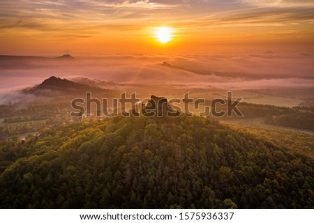 Oltarik is a castle ruin on the hill of the same name in the Ceske stredohori Mountains. It rises above the village of Dekovka ten kilometers southwest of Lovosice in the district of Litomerice #1575936337