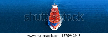 Aerial drone panoramic photo of industrial oil and fuel tanker ship cruising deep blue open ocean sea