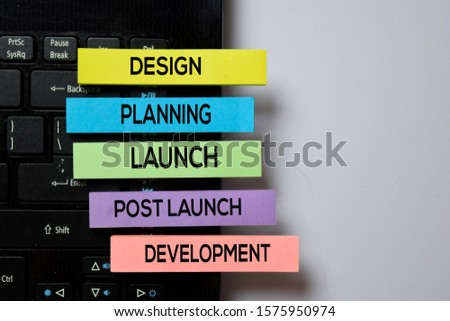 Design, Planning, Launch, Post Launch, Development write on sticky notes with keyboard laptop isolated on white board background #1575950974