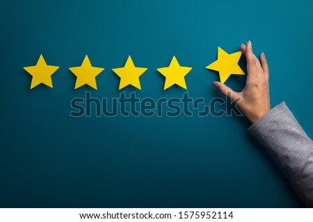 Satisfaction concept. Woman hand giving five star rating on green background, copy space #1575952114