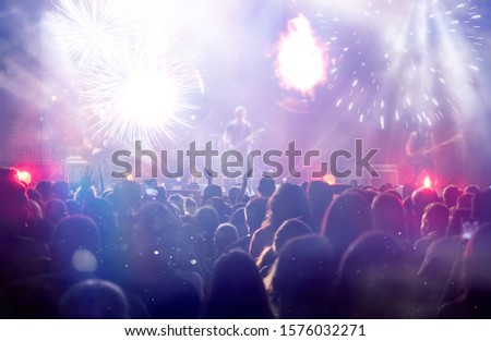 New Year concept - fireworks and cheering crowd celebrating the New Year #1576032271
