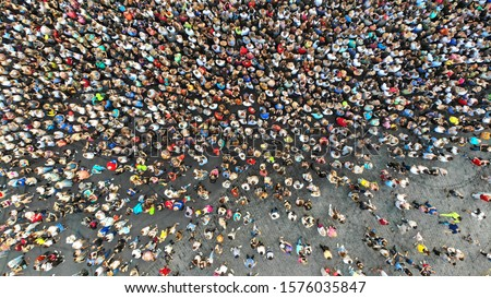Aerial. Interested crowd of people in one place. Top view from drone. #1576035847