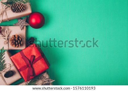 Christmas fir tree with decoration on striped green background #1576110193